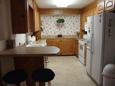 Fully equipped galley kitchen, off living area