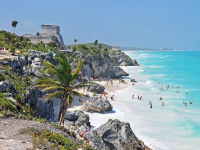 Catch a bus to Tulum for about $10 :)