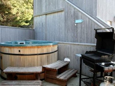 Hot tub located off back deck with gas barbecue