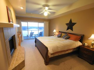 Lake Ozark condo photo - King Master Suite 1 of 2 w/ Private Full Bath, Lake View, Door to Deck & Crib
