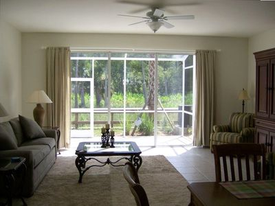 "Great room overlooking screened lanai and nature preserve, 32"" TV on right"