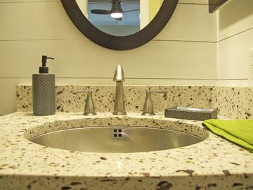 Chic wood clad walls, stainless sinks & Silestone counters in bthrm 2 & 3.