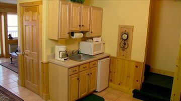 Convenient kitchenette located downstairs