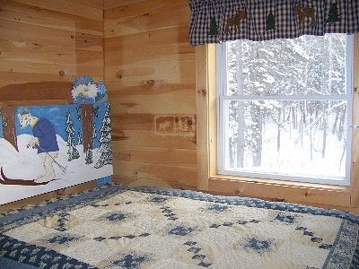 The 'polar bear' bedroom, with views of the back woods/ full bed