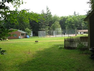 Lincoln cabin photo - view from the side of the Cabin looking at the tennis court