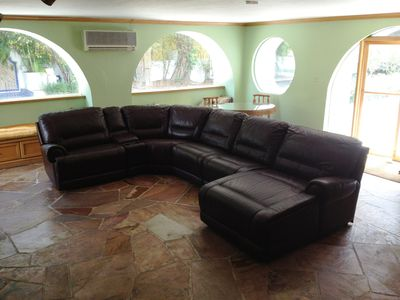 Immense entertainment room complete with TV and Wet Bar for your enjoyment