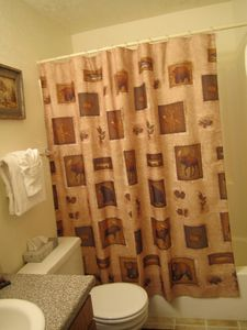 Main Bathroom -- shower curtain continues wildlife theme.