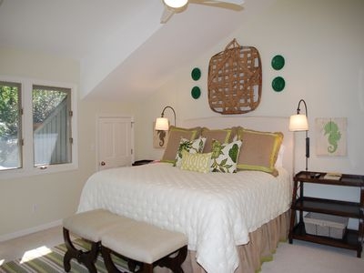 Upstairs guest bedroom with King Bed, TV and private bathroom - golf course view