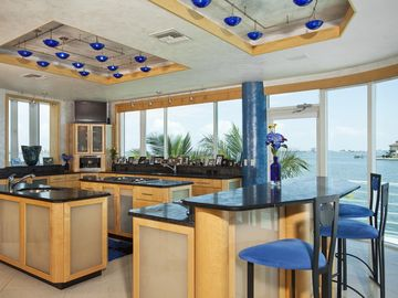 Three large island kitchen,9 cook tops,5 gas,2 electric&2 grill.CHEFS DREAM!
