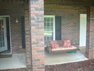 Lake Norman house photo - Porch swing is on lake side. Door opens to downstairs living area.