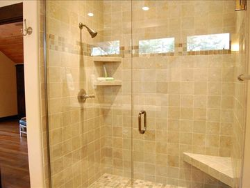 Guest bathroom with walk-in shower tiled with natural slate