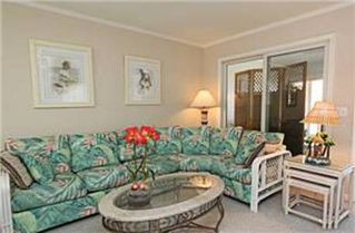 North Ocean City townhome photo - View of the couch with the coffee table and side nested snack tables.