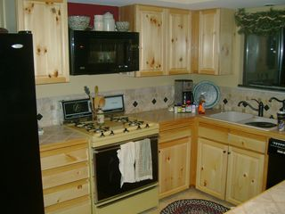 Walker cabin photo - Kitchen with gas stove, dishwater, microwave, coffee maker and toaster.