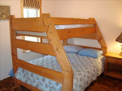 Bedroom with double bed with single above