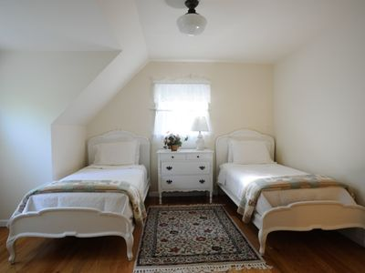 Second floor bedroom with two twin beds.