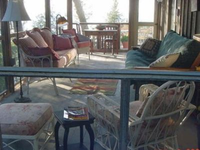 Relax on the large screened in porch