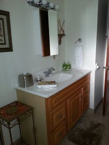 Second bath, between the front bedroom and living room, features a shower stall