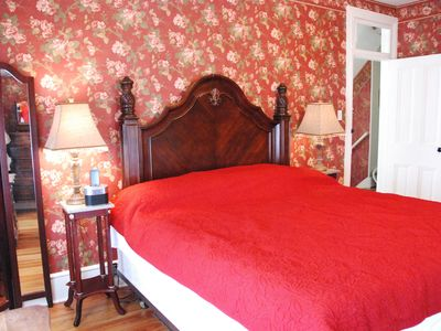 Extra large bedroom with king size bed and antiques. iPod / iPhone dock in room