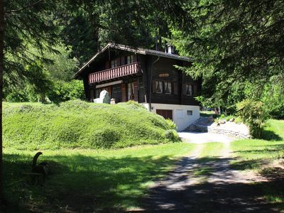 Located in a clearing with forest, river and private pond.