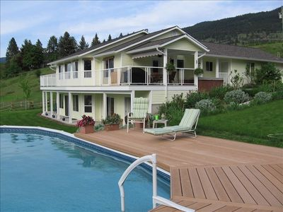 Enjoy the view from the heated pool and huge deck