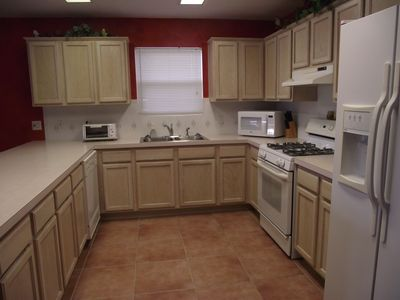 Vacation Homes in Holiday Isle Destin townhome rental - Kitchen has Gas Stove, Micro, Ice Maker and Water in Fridge and Fully Equiped