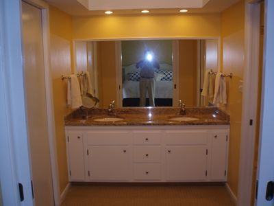 master BR bath dressing room, shower/commode to right, walk in closet to left