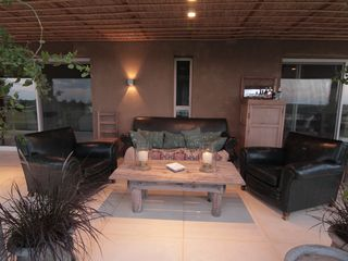 Maldonado farmhouse photo - PATIO: EXTERIOR LIVING ROOM, BAR CABINET AND COFFE TABLE.