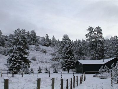 Winter view of the cabin from the front of the property