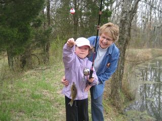 Nashville cottage photo - Owner, Delores with granddaughter and her first fish from Willow Pond.