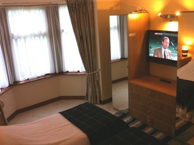 Master bedroom with digital flat screen TV