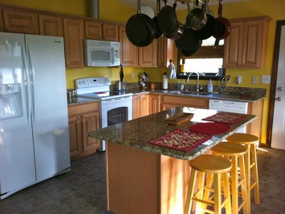 Kitchen is completely stocked. All appliances are new with granite countertops.