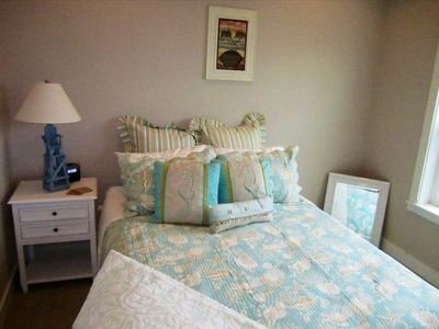 Bedroom with seaside decor and ensuite