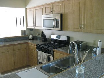 kitchen with granite counters and all SS appliances