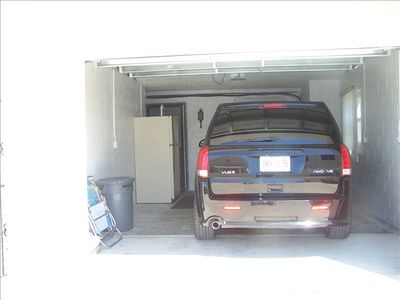 One car garage attatched for lower level with extra fridge and entry into unit.