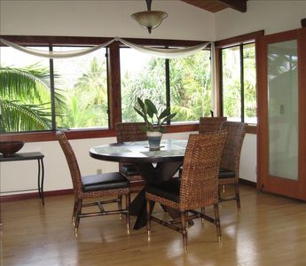 Dining area with tropical views comfortably seats 7.