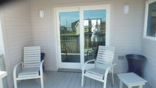 Galveston house photo - Sliding door to Bonus room with covered deck sitting area