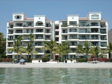 Building and Beach - our unit is on third floor-the two balconies far right side