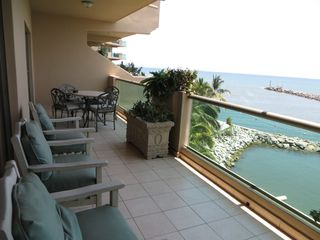 Nuevo Vallarta condo photo - Full-length living room/ master Balcony overlooking harbour entrance. Dine out!