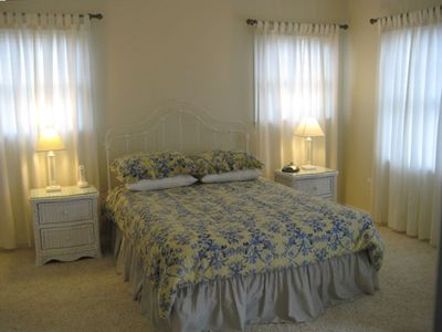 Master bedroom suite with queen bed and full bath.