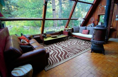 Living room looking out into forest...