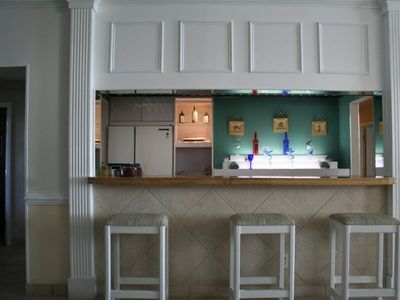 Bar with sink and full size refrigerator