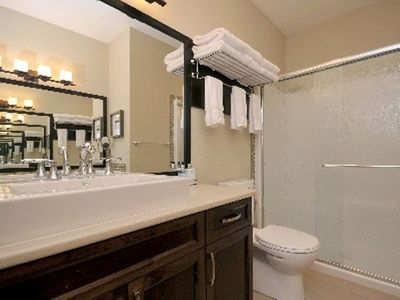 Spa like bathroom with full shower with rain head and bathroom amenities