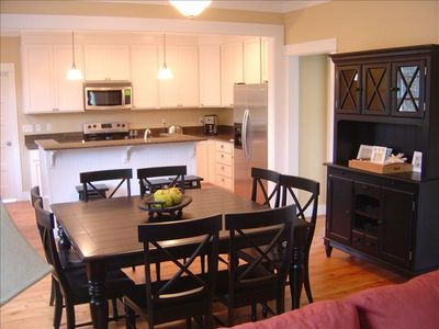 Kitchen with granite counter tops and large dining area for 12