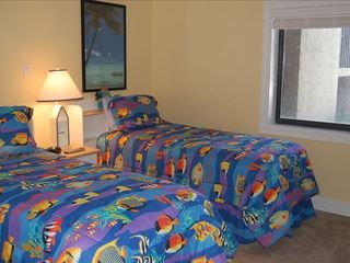 Perdido Key condo photo - Tropical Twin Bedroom with tv and access to bath with granite countertop!