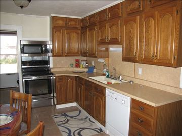 Full Kitchen includes dishwasher, microwave, stove/oven, and refrigerator