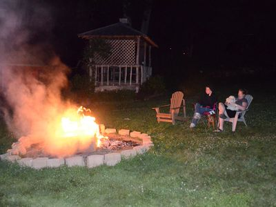 The fire pit is often enjoyed by guests and innkeepers as a gathering spot