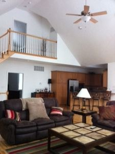 Great Room & view of 3rd floor balcony / entrance to 2nd master suite