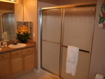 Master en-suite shower room with walk in closet