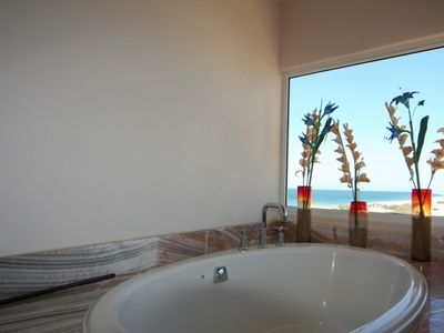 View to the private Pacific beach from the sunken tub