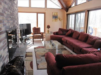 Gather by the large fireplace in this spacious room ideal for family gatherings.